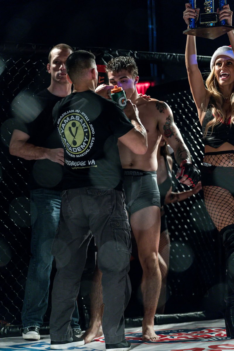 Christian Esquilin with his coaches at Cagezilla 59