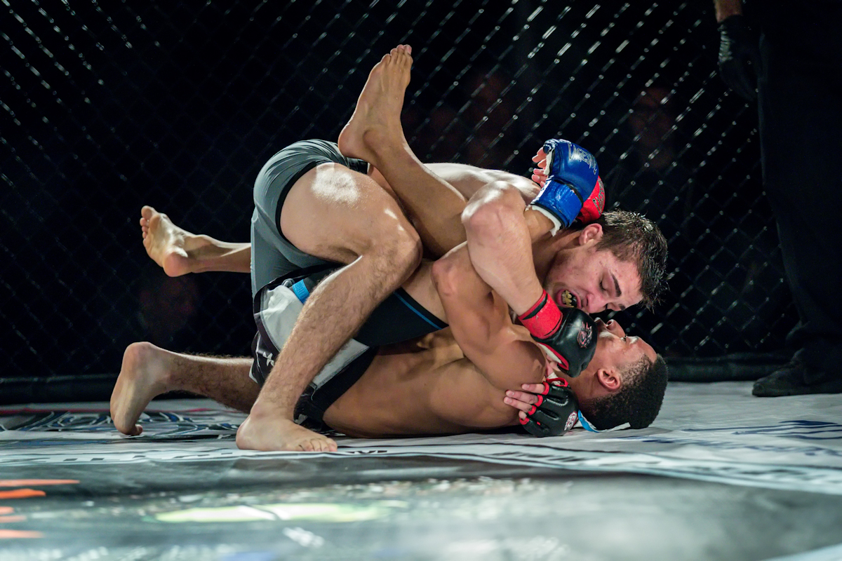 Christian Esquilin ground and pounds his opponent